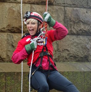Excited lady on the Forth rail Bridge Abseil